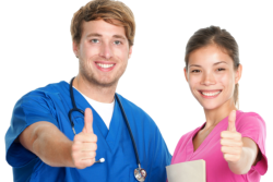 Two nurses doing the thumbs-up sign